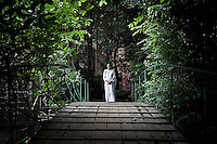 "MAE CHEE TIAP carries out a walking meditation as a spiritual practice to chill out the mind and get awarness over the body. Vanished by centuries the lineage of ""Bhikkhu?nii"" (Order of Nuns) has been brought to the ongoing Thai society's debate. White-clad thai nuns, who keep the eight precepts and have their heads and eyebrows shaved are known as the lon-existing ""mae chees"" (low category to call the lay nuns). Females who have turned to religous life, as renunciants, live ostracized and marginalized by the Sangha (Buddhist community) and Thai society, denying them full access to the monastic life as well as rights and support from the government. Today nunhood is not recognized by any asian country belong to the Theravada Buddhist order. Most of the eight precept holders live in temples run by male abbots, at the shadow of the monks; with the exceptional existence of a few para-monastic institutions as the Sathira Dhammasathan meditation centre, where ""mae chees"" are not allow to held a temple, but not denied to practice the spiritual life."