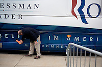 A man polishes the Romney campaign bus outside a Mitt Romney town hall meeting and rally at the Rochester Opera House in Rochester, New Hampshire, on Jan. 8, 2012. Romney is seeking the 2012 Republican presidential nomination.