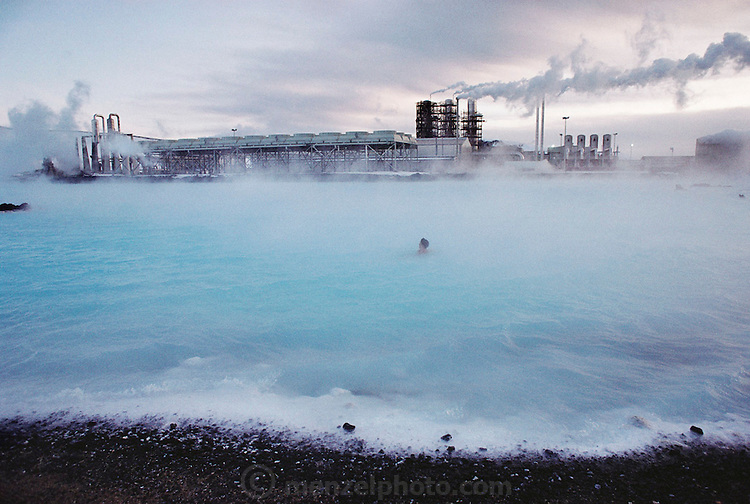 The Blue Lagoon, a surreal-looking spa created near the Svartsengi power plant, outside Iceland's capital city of Reykjavik, Iceland. Pumping 470 F (243 C) water from up to 1-1/4 miles beneath the earth, the plant generates electricity ? and a somewhat cooler runoff that is rich in the kind of silicates and salts loved by devotees of mineral baths. Bathing is permitted only in the 2.5-acre (1 ha.) patch of the lake in which the water temperature is cool enough. Environment. Published in the book Material World: A Global Family Portrait, pages 168-169.