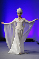 Model walks runway in a Bridal Couture dress by Isabel Zapardiez, during Couture Fashion Week New York Fall 2012.