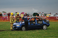 BNPS.co.uk (01202 558833)<br /> Picture: BNPS<br /> <br /> This is the remains of the charred car moments after show marshalls and the Fire and Rescue Service rushed to stop the flaming vehicle careering into a near food truck.<br /> <br /> The car was part of a demonstration at the Somerset Steam and Country Fair at Low Ham, near Langport, in Somerset as part of their car fire demonstration.