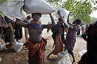 After the government shuts down flood recession agriculture by putting the Gibe III dam online, the only other options for these tribes feeding themselves are water pumps for agriculture (that don't work well here) and FOOD AID...Food aid is problematic because most of the grain that is handed out is subsequently fermented for alcohol...These tribes would have ceremonies at the end of each harvest because there was grain to ferment and they could party and reflect on a successful crop.  With year-round food aid these tribes can be drunk on fermented grain for the entire year...This is food aid in the Nyangatom town called Kangaten.  The Turkana raided the Nyangatom and took 13,000 cattle so theNyangatom have moved into this town that is a food distribution hub for NGOs who have transferred a bulk of the food aid to this town because the people here have no food and no means of support.