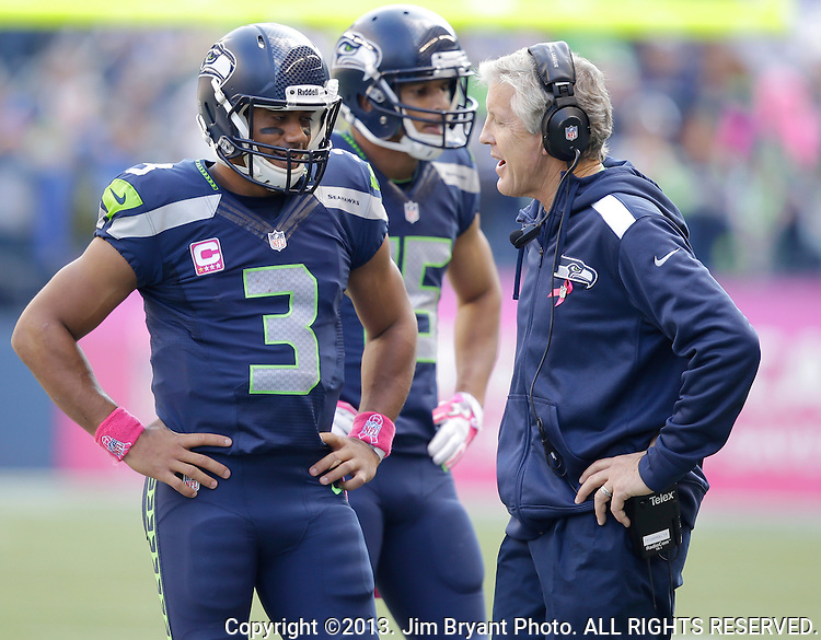Seattle Seahawks quarterback Russell Wilson (3) talks with head coach Pete Carroll during a time out called against the Tennessee Titians at CenturyLink Field in Seattle, Washington on  October 13, 2013. The Seattle Seahawks beat the Titians  20-13.   ©2013. Jim Bryant Photo. All Rights Reserved.