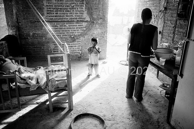 Culiacan, Mexico<br /> June 12, 2007<br /> <br /> Two poor families live in an abandon house that was half built, in a poorer area of the city. The poor in Culiacan live near many extremely wealthy people who have made their fortunes from the drug trade with the United States.