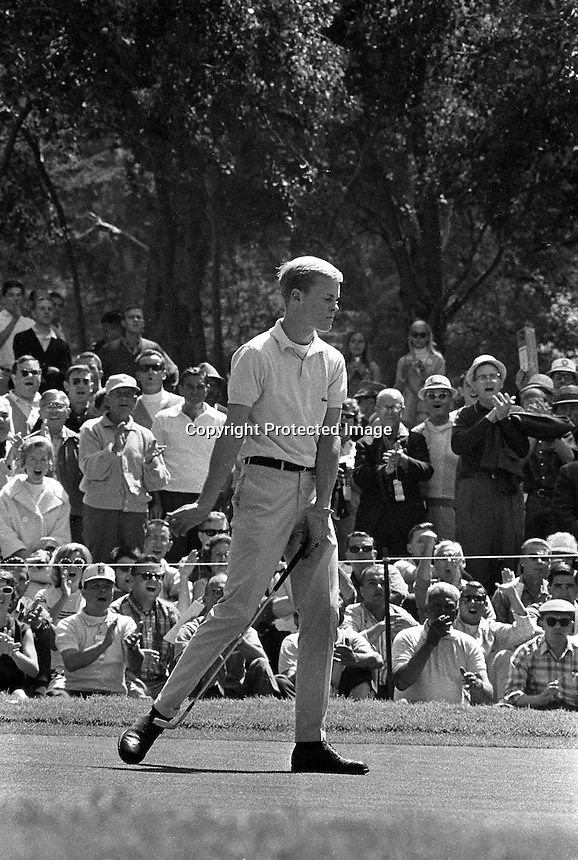 Young Johnny Miller sinks a putt at the 1966 U.S. Open tournament at the Olympic Club in San Francisco, Ca.<br />(photo by Ron Riesterer)