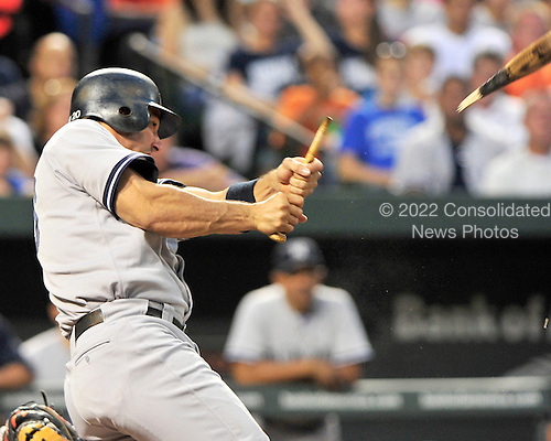 New York Yankees designated hitter Jorge Posada (20) breaks his bat in first inning action against the Baltimore Orioles at Oriole Park at Camden Yards in Baltimore, MD on Friday, August 26, 2011..Credit: Ron Sachs / CNP.(RESTRICTION: NO New York or New Jersey Newspapers or newspapers within a 75 mile radius of New York City)