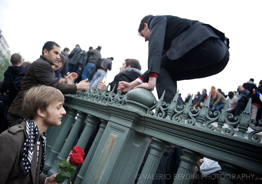 People jumps over the fence to get up onto the July column, commemorating July (1830) revolution, at the centre of the place.