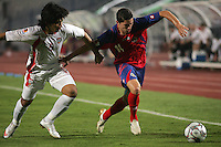 United Arab Emirates' Amer Abdulrahman (5)  tangles with Costa Rica's Bryan Oviedo (14) during the FIFA Under 20 World Cup Quarter-final match at the Cairo International Stadium in Cairo, Egypt, on October 10, 2009. Costa Rica won the match 1-2 in overtime play.