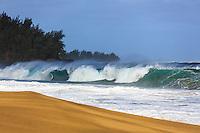 A large winter swell breaks onto the sand at Lumaha'i Beach on the north shore of Kaua'i.