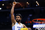 North Carolina Tar Heels guard Joel Berry II holds up a piece of the net after they defeated the Kentucky Wildcats during the 2017 NCAA Men's Basketball Tournament South Regional Elite 8 at FedExForum in Memphis, TN on Friday March 24, 2017. Photo by Michael Reaves | Staff
