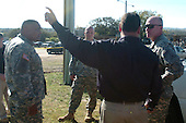 Fort Hood, TX - November 5, 2009 -- Lieutenant General Robert Cone (right), III Corps commanding general and the corps' senior noncommissioned officer, Command Sergeant Major Arthur L. Coleman, Jr., receive a briefing from Fort Hood law enforcement officers outside the shooting site.  Thirteen people died and 30 more were wounded in the incident Thursday, November 5, 2009.   .Mandatory Credit: Jason R. Krawczyk - U.S. Army via CNP