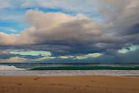 At sunrise, a wave breaks along the shoreline at Kauna'oa Bay and Beach (a.k.a. Mauna Kea Beach), Big Island.