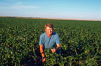 Portrait of a farmer in his corn field, early July.