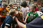 CHAD PILSTER &bull;&nbsp;Hays Daily News<br /> <br /> Logan Hook, left, 1, kisses one of the foal's as Gage Hallam, right, 4, watches Marion Schmidt, top right right, the owner, tells the kids about the miniature horses on Monday, June 3, 2013, at the Blue Sky Miniature Horse Farm in Hays, Kansas. Hays Rec took a group of kids out to the farm to learn about some of the smallest horses in Kansas.