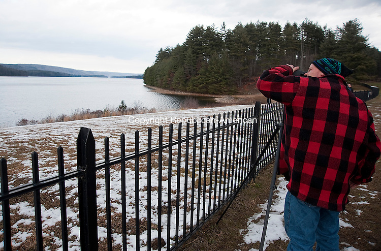 BARKHAMSTED, CT 20 JANUARY 2013- 012013JS05--  Barry Stadler of Barkhamsted uses a spotting scope to watch a Bald Eagle across the Barkhamsted Reservoir on Sunday.  The MDC has a proposal that is one of three UConn is considering that can send 2 million gallons of water to its Storrs campus. Area residents, town officials and environmentalists are concerned about the impact it would have on the Farmington River. .Jim Shannon Republican American .