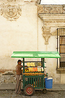 Fruit street vendor in Antigua, Guatemala. Antigua is a UNESCO World heritage site...