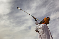 Court musician play kakaki horn outside of Zazzau Emir's Palace, Zaria, Nigeria.