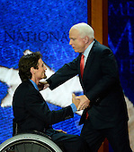 United States Senator John McCain (Republican of Arizona) meets Para-Olympian Chris Devon Young at the 2012 Republican National Convention in Tampa Bay, Florida on Wednesday, August 29, 2012.  .Credit: Ron Sachs / CNP.(RESTRICTION: NO New York or New Jersey Newspapers or newspapers within a 75 mile radius of New York City)