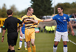 Lee Wallace would like words with Martin McMullan