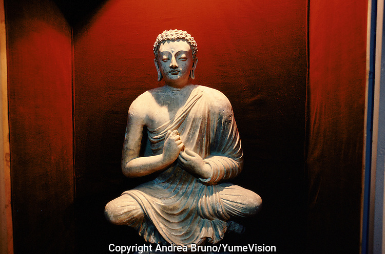 A Sculpture of Buddha. .Under the Najibullah government, the National Museum was protect and intact. .100% of the sculptures have been loot and appear in the 90â, in a auction sale in London, Paris, New York, Tokyo.