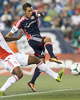 New England Revolution midfielder Diego Fagundez (14) from close in fails to score. In a Major League Soccer (MLS) match, Toronto FC (white/red) defeated the New England Revolution (blue), 1-0, at Gillette Stadium on August 4, 2013.