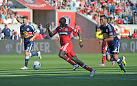 Chicago forward Dominic Oduro (8) dribbles away from New York defender Wilman Conde (2).  The Chicago Fire defeated the New York Red Bulls 3-1 at Toyota Park in Bridgeview, IL on June 17, 2012.
