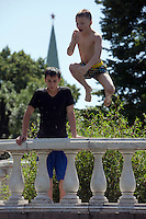 Moscow, Russia, 25/06/2010..A boy jumps into fountains next to the Kremlin and Red Square during a heatwave that has seen temperatures of up to 37C, a record for the month of June.