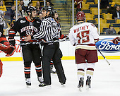 Anthony Bitetto (Northeastern - 7), Chris Aughe, Joe Whitney (BC - 15) - The Boston College Eagles defeated the Northeastern University Huskies 5-4 in their Hockey East Semi-Final on Friday, March 18, 2011, at TD Garden in Boston, Massachusetts.