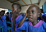 Students sing a song with hand motions in a Catholic school in Malakal, Southern Sudan.