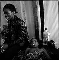 Luanda, Angola, May 20, 2006.Faustinho, 10, is a patient at the Cacuaco MSF Belgium operated cholera field clinic. Between February and June 2006, more than 30000 people were infected with cholera in Angola's worse outbreak ever; more than 1300 died.
