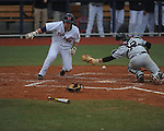 Ole Miss' Tanner Mathis (12) scores vs. Arkansas-Pine Bluff catcher Tyler Oertle (12) at Oxford-University Stadium in Oxford, Miss. on Wednesday, February 27, 2013.