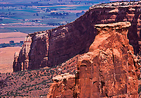 Colorado, Grand Junction, Colorado National Monument, elevated view of Canyon, Butte, farm fields in distance