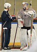 Joe Exter (USA - Assistant Coach), Jack Campbell (USA - 1) - Team USA practiced at the Agriplace rink on Monday, December 28, 2009, in Saskatoon, Saskatchewan, during the 2010 World Juniors tournament.
