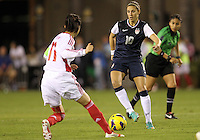 BOCA RATON, FL - DECEMBER 15, 2012: Carli Lloyd (10) of the USA WNT moves in on Pu Wei (11) of China WNT during an international friendly match at FAU Stadium, in Boca Raton, Florida, on Saturday, December 15, 2012. USA won 4-1.