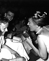 Twenty-one year old James R. Gould is the envy of 3,000 crewmemberrs as television actress Kathleen Nolan singles him out for a song.  The young sailor and Bon Homme Richard both celebrated their &quot;coming of age&quot; on November 26, 1965. (USIA)<br /> NARA FILE #:  306-MVP-8-6<br /> WAR &amp; CONFLICT BOOK #:  392