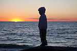 Kid Standing, Silhouette at Sunset