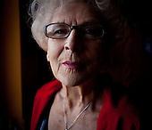 WARSAW, POLAND, NOVEMBER 2011:.Wika Szmyt, 74 year old DJ, at home..Wika is famous in Poland for being the oldest DJ. Twice a week she runs discos at the Bolek club in Warsaw, frequented mainly by the pensioners..(Photo by Piotr Malecki/Napo Images)..WARSZAWA, LISTOPAD 2011:.DJ Wika, w domu z telefonem komorkowym. Wika Szmyt, 74-letnia DJ jest znana jako najstarsza didzejka w Polsce. Dwa razy w tygodniu prowadzi dyskoteki w klubie Bolek, na ktore przychodza glownie emeryci..Fot: Piotr Malecki/Napo Images.***ZAKAZ PUBLIKACJI W TABLOIDACH I PORTALACH PLOTKARSKICH*** .*** Zdjecie moze byc uzyte w prasie, gdy sposob jego wykorzystania oraz podpis nie obrazaja osob znajdujacych sie na fotografii ***.