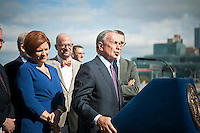 NY Mayor Mike Bloomberg (R) speaks with City Council Speaker Christine Quinn (L) next to him at the groundbreaking ceremony for the third segment of the High Line Park, covering West 30th to West 34th Streets in New York, on Thursday, September 20, 2012.The final phase of the popular park is scheduled to open in 2014 and over ten million visitors have toured the park since its opening in 2009.   (© Richard B. Levine)