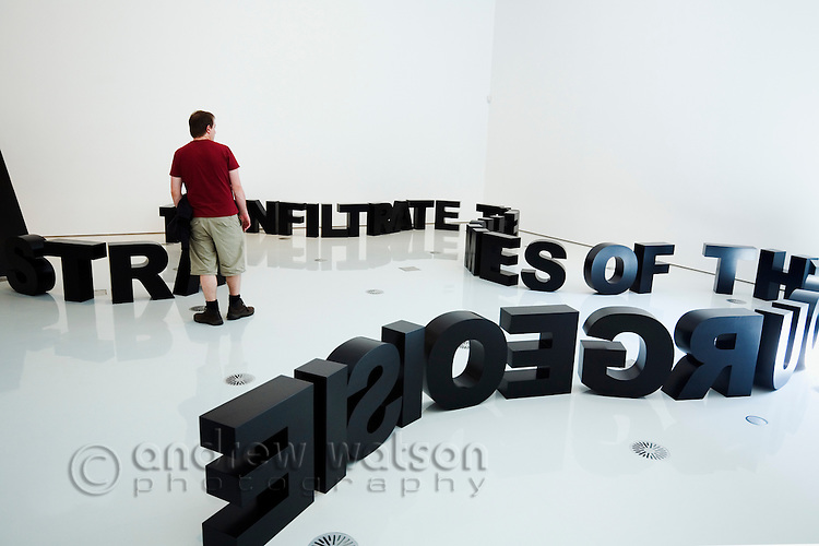 A man looks at a quirky exhibition at the National Gallery of Victoria in Melbourne, Victoria, AUSTRALIA.