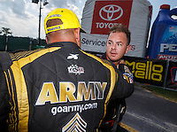 Sep 5, 2016; Clermont, IN, USA; NHRA top fuel driver Steve Torrence (right) congratulates Tony Schumacher as he celebrates after winning the US Nationals at Lucas Oil Raceway. Mandatory Credit: Mark J. Rebilas-USA TODAY Sports
