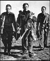 BNPS.co.uk (01202 558833)<br /> Pic: Pen&amp;Sword/BNPS<br /> <br /> Returning to the crew room at Aston Down after a training exercise with a Canadian pupil pilot; slightly behind them is Pilot Officer Jones, the instructor.<br /> <br /> he remarkable story of a British hero double amputee pilot who took to the skies during the Second World War has come to light.<br /> <br /> Flight Lieutenant Colin Hodgkinson lost his legs in a horror crash in a Tiger Moth in May 1939 but went on to emulate Sir Douglas Bader and fly Spitfires in the Royal Air Force.<br /> <br /> He even endured a spell in the Great Escape prisoner of war camp after being shot down over France in 1943 but rejoined the RAF after being repatriated.<br /> <br /> The pair were the only two British double amputee pilots to fly during the war - yet while Bader, rightly, is a household name, Flt Lt Hodgkinson's exploits have been largely forgotten.<br /> <br /> This has prompted historian Mark Hillier to publish Flt Lt Hodgkinson's autobiography 60 years after it was penned which he hopes will shine some limelight on a 'special' man whose courage he says was every bit as great as Baders'.<br /> <br /> Best Foot Forward, by Colin Hodgkinson, is published by Pen &amp; Sword.