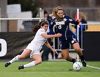 Melissa Henerson (6) of Notre Dame works her way around Elizabeth Sullivan (7) of Ohio State during the first game of the NCAA Women's College Cup at WakeMed Soccer Park in Cary, NC.  Notre Dame defeated Ohio State, 1-0.