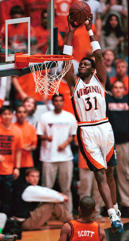 Adam Hall towers above the rest with a dunk during the 1st half of the UVa-Clemson basketball game play in Charlottesville, Virginia February 28, 2001. ( Photo/Andrew Shurtleff/The Daily Progress)