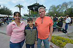 """Elizabeth Bermudez (left) and her son Kevin and husband Emilio Gonzalez pose in the Plaza Benito Juarez in Nuevo Laredo, Mexico, on March 3, 2017. They are among hundreds of Cubans stuck in the border city, caught in limbo by the elimination in January of the infamous """"wet foot, dry foot"""" policy of the United States. They are not allowed to enter the U.S. yet most don't want to return to Cuba. Many of the city's churches have become temporary shelters for the immigrants, and congregations rotate responsibility for feeding the Cubans, who have slowly been forced to appreciate Mexican cuisine. Such solidarity from ordinary Mexicans will be tested in coming months, as not only are the Cubans stuck at the border, but the U.S. has stepped up deportations of Mexican nationals, while at the same time detaining many undocumented workers from other nations and simply dumping them on the US-Mexico border."""