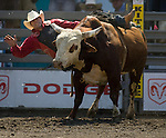 Jess Bail, from Camp Crook, S.D. is bucked off by Dennis during the Xtreme Bull Riding Competition at the Kitsap County Fair and Stampede  held Aug. 26 to Aug. 30, 2009 in Silverdale, WA. Jim Bryant Photo. All Rights Reserved. © 2009