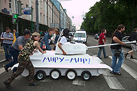 Moscow, Russia, 19/05/2012..Artists wheel a mock tank with the slogan &quot;Peace to the world&quot; in front of a police car as several thousand artists and opposition activists demonstrate against Vladimir Putin by walking through Moscow transporting their artworks. The protest coincided with Museum Night, when Moscow's museums are open until midnight with special exhibitions and performances.
