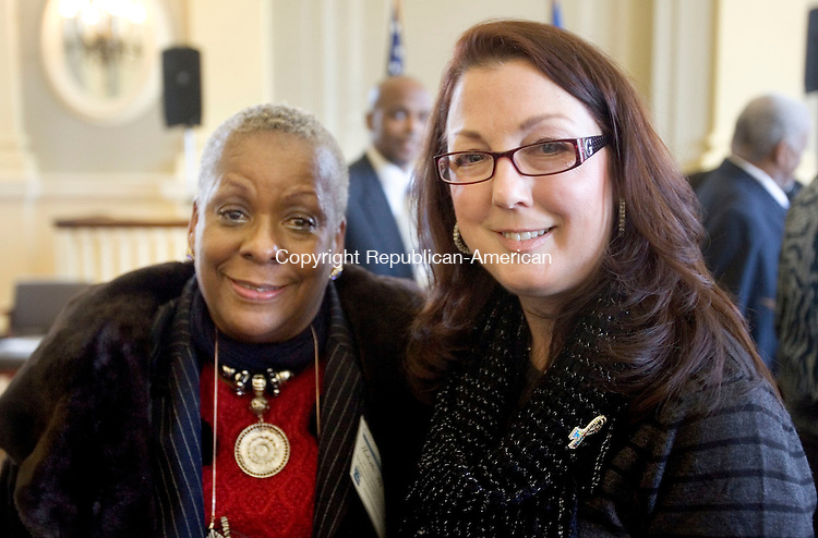 WATERBURY CT. 06 February 2015-020615SV12-From left, Paulette Fox of New Britain and Sharon Saavedra of New Britain, president of New Britain board of education, attend the Standing on the Shoulders of Giants, a Black History Month program honoring the outstanding work of African-American community leaders across central and northwest Connecticut, hosted by Rep. Elizabeth H. Esty, D-5th District at City Hall in Waterbury Friday.  <br /> Steven Valenti Republican-American