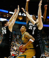 PITTSBURGH, PA - MARCH 21: Zach Auguste #30 of the Notre Dame Fighting Irish looks to put up a shot while being guarded by Kellen Dunham #23, Kameron Woods #31, and Steven Bennett #25 of the Butler Bulldogs in the second half during the third round of the 2015 NCAA Men's Basketball Tournament at Consol Energy Center on March 21, 2015 in Pittsburgh, Pennsylvania.  (Photo by Jared Wickerham/Getty Images)