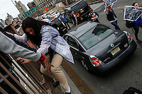 A woman climbs de brooklyn bridge as she takes part during a protest against police brutality against minorities, 04.13.2015. in New York city Kena Betancur/VIEWpress.
