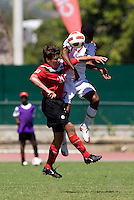Michael Petrasso (20) of Canada goes up for a header with Kiel Pierre (17) of Trinidad & Tobago during the quarterfinals of the CONCACAF Men's Under 17 Championship at Catherine Hall Stadium in Montego Bay, Jamaica. Canada defeated Trinidad & Tobago, 2-0.